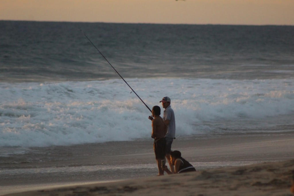 Fishing with family on the beach